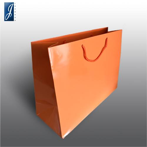Currency big orange paper bag