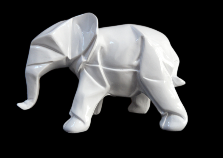 small white resin elephant animal figurine