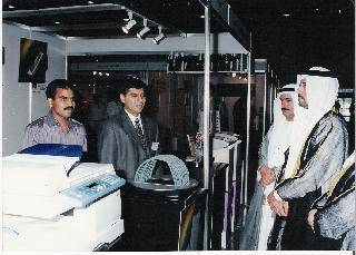 H.E Mr Abdul Rehman Mutawiee D.G DCCI at Total Office Products Stand with Mr.Amir Ali during Shopa D