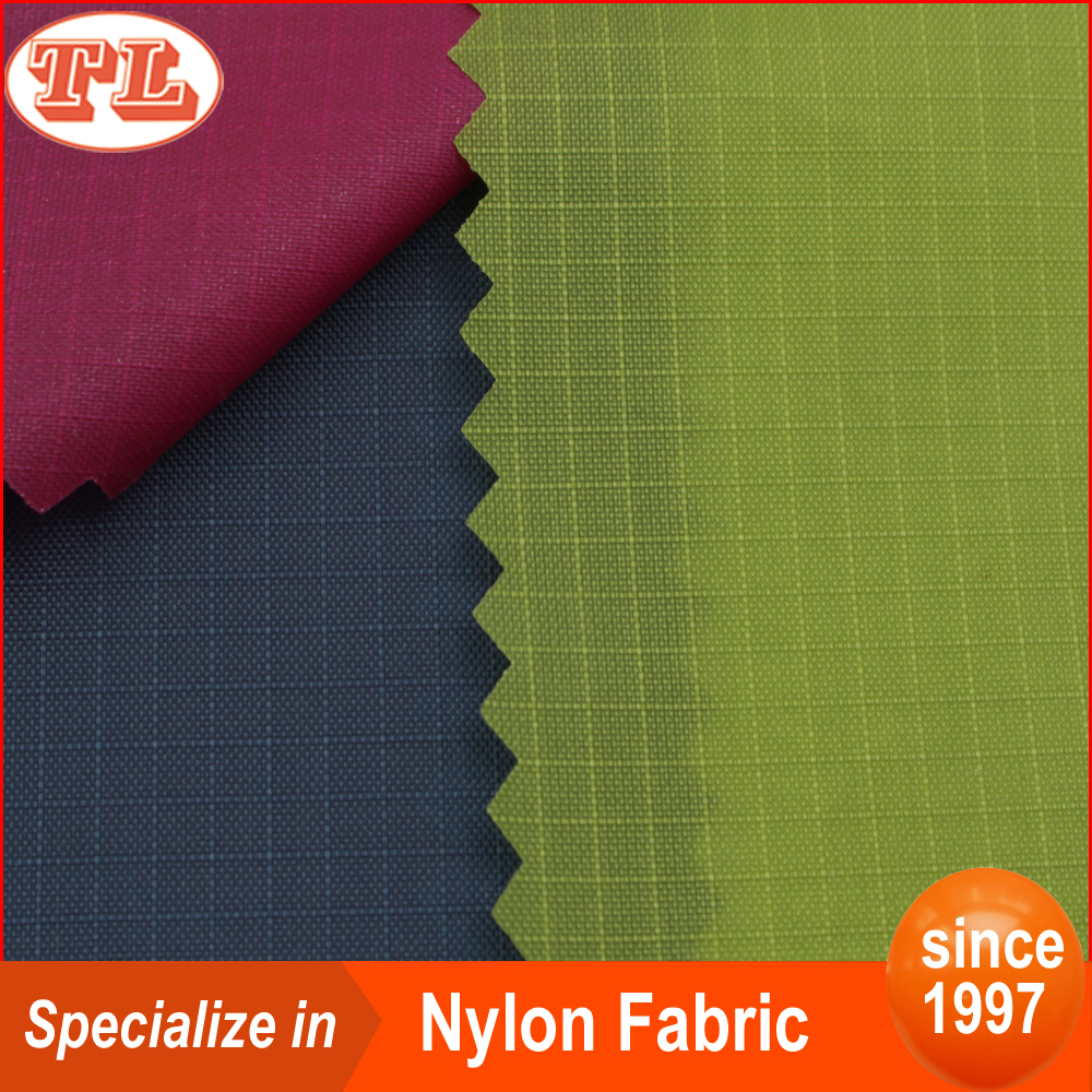 eco-friendly waterproof 0.3 grid 210t ripstop nylon taffeta fabric with pu coated