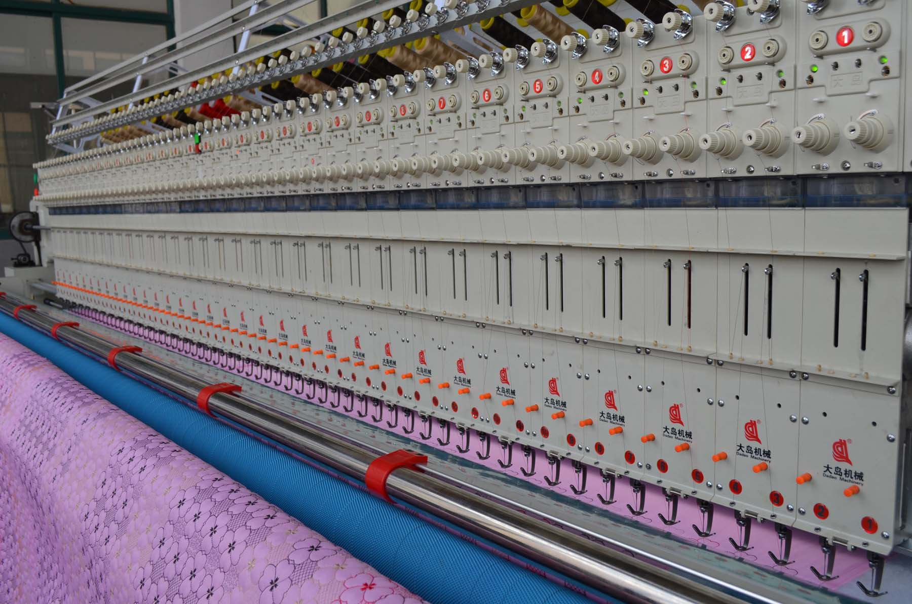 Quilting embroidery machine for producing home textiles, apparel, mats, curtains...