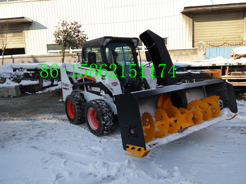 Skid loader snow blade