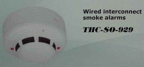 Wired interconnect smoke alarms