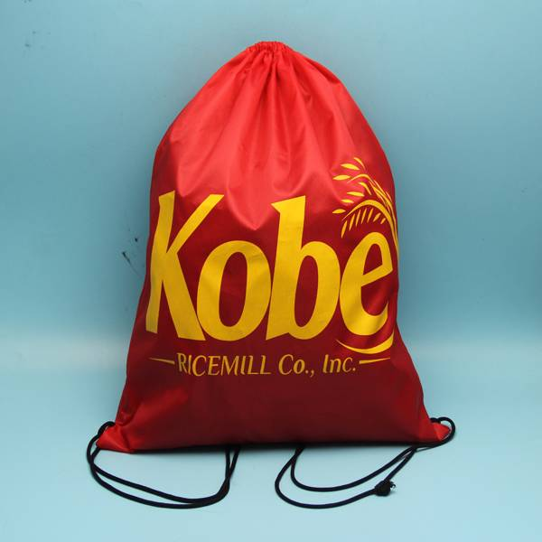 wholesale red color polyester backpack bag with yellow printing