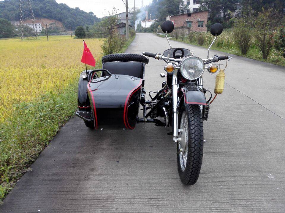 Bright black motorcycle sidecar with 750cc engine