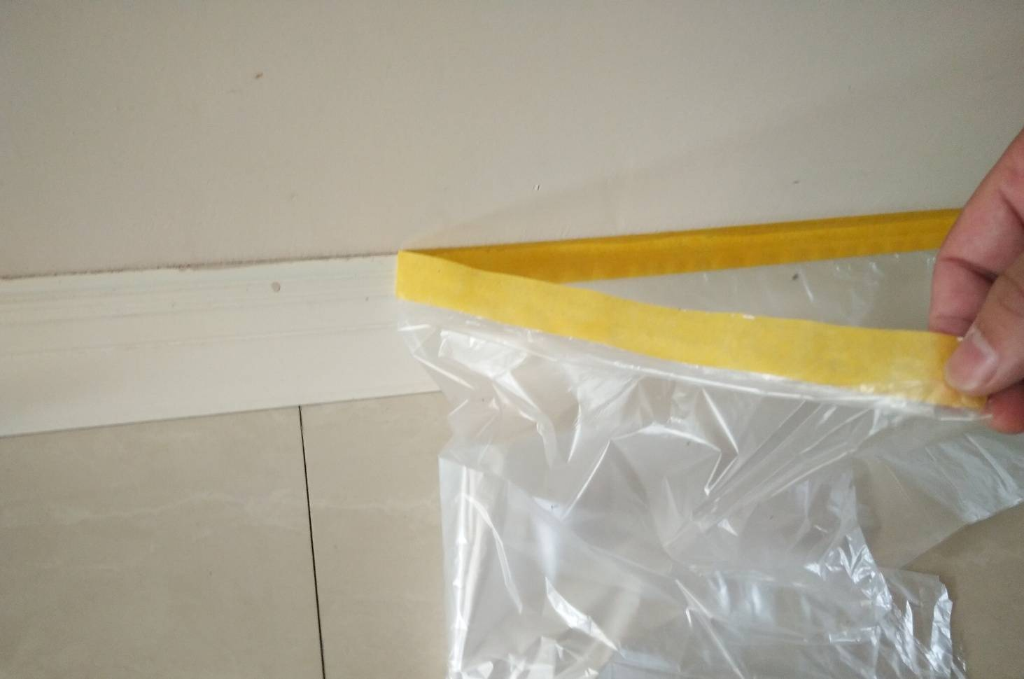 pre-taped painter's plastic film