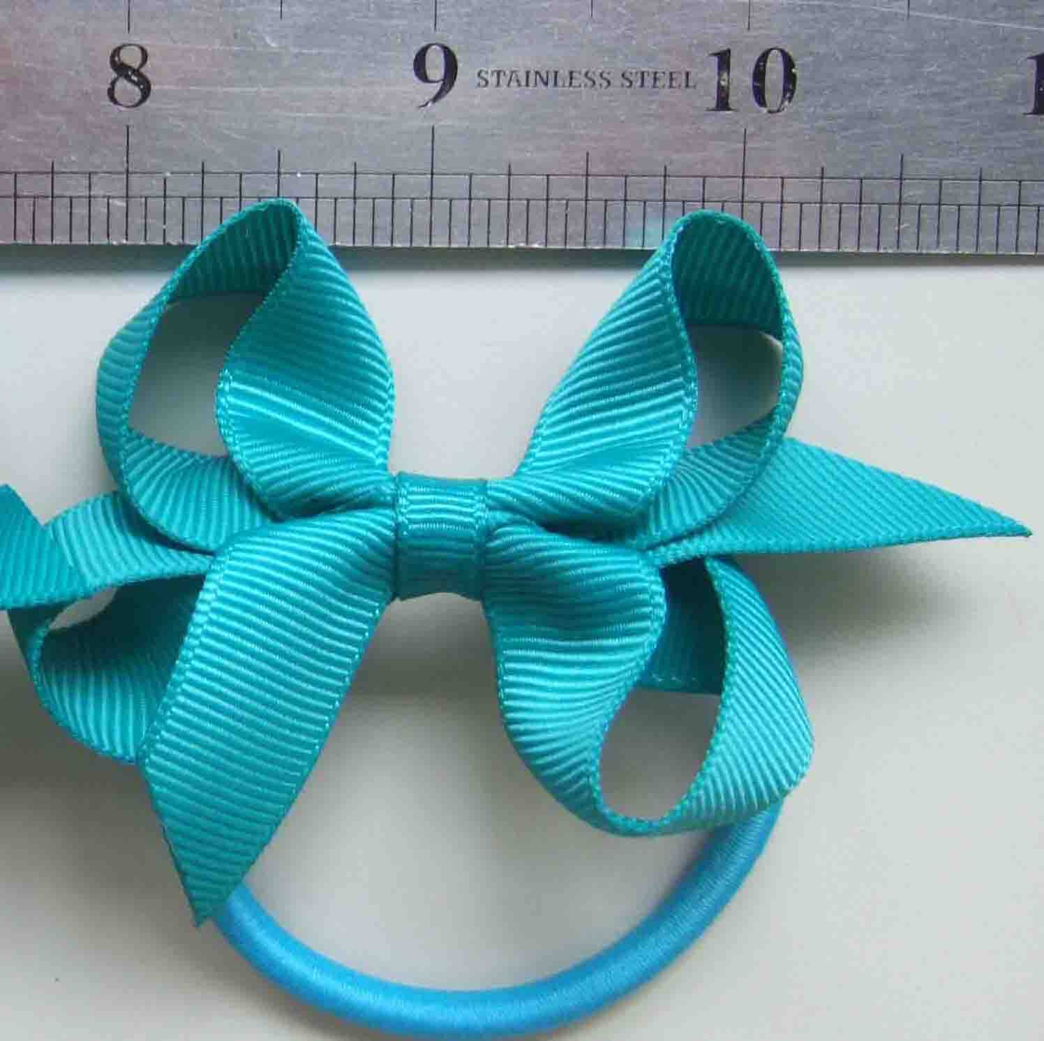 Medaline hair bows,elastic band,girls bows,hair clip,bitty bows,boutique bows,grosgrain bows