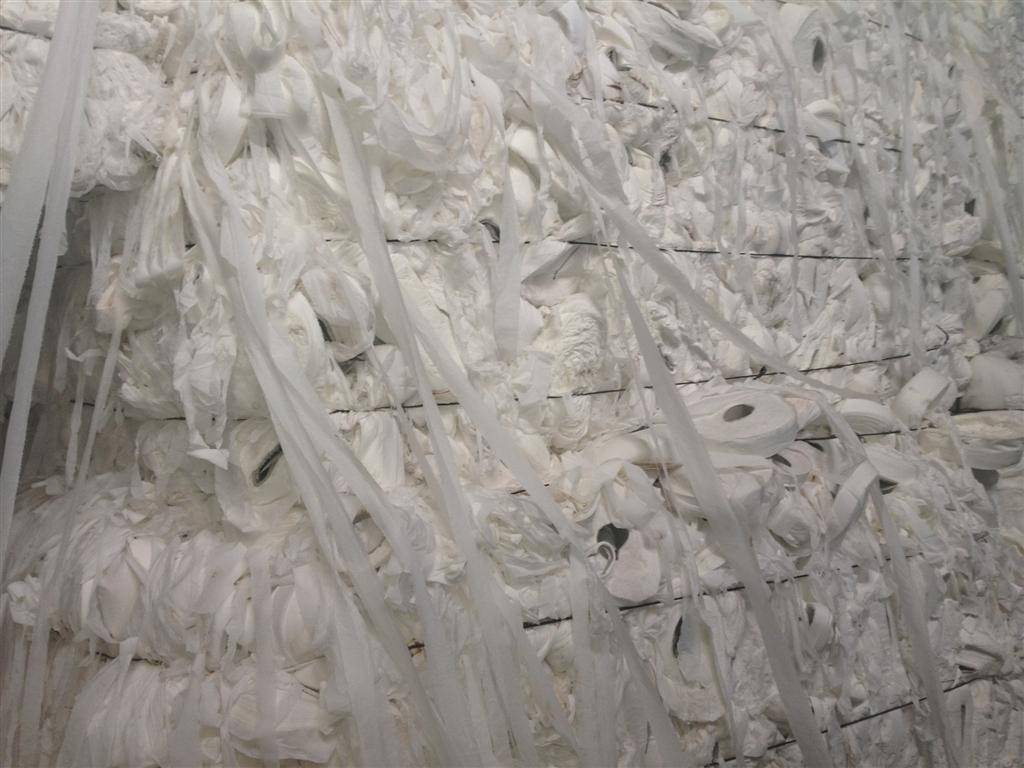 Waste white tissue in bales with cores from Greece