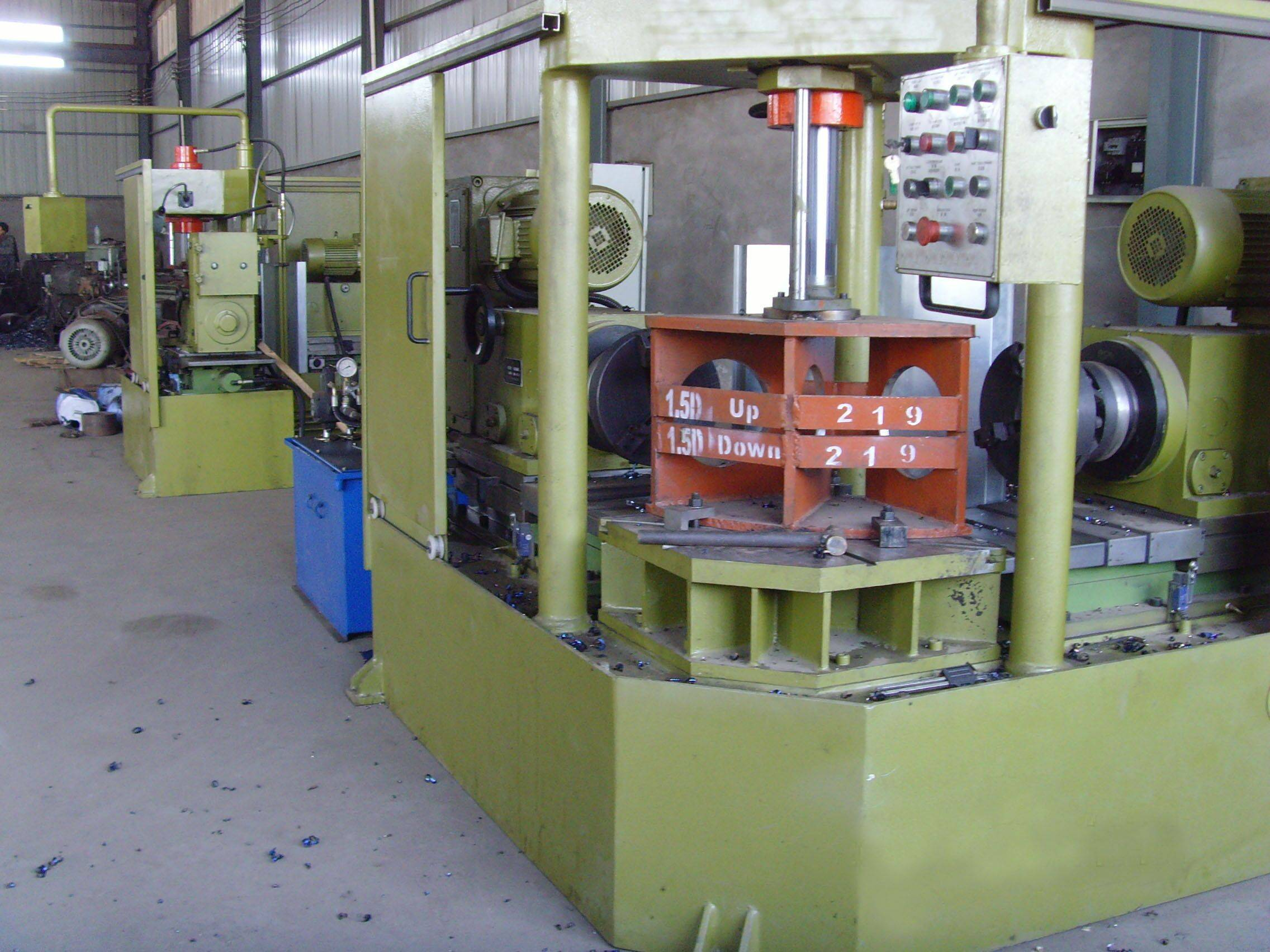 elbow beveling machine with two head