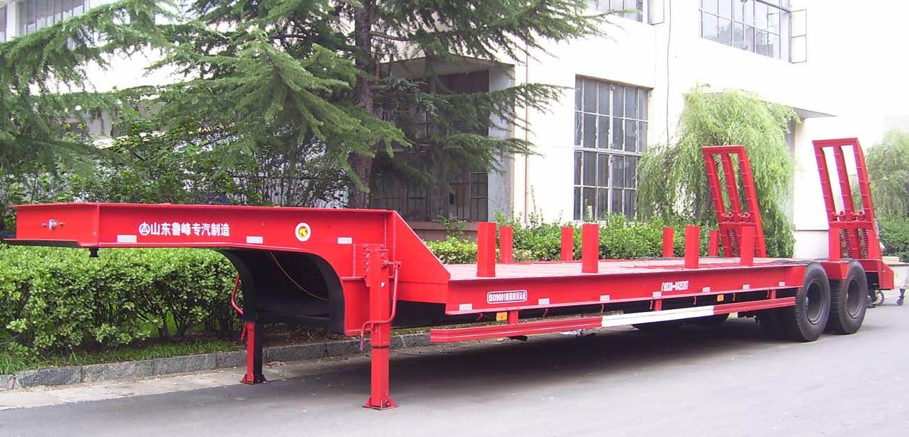 Two axles lowbed semi trailer to transport heavy machines