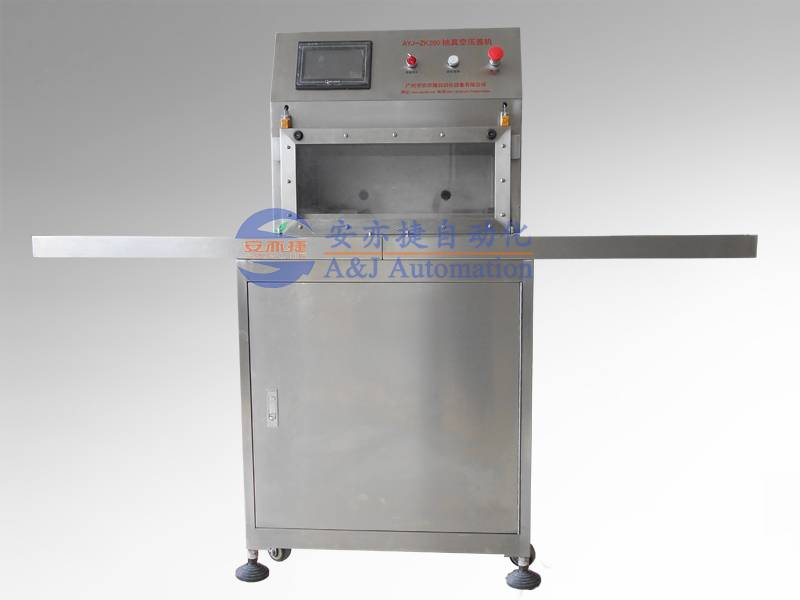 Automatic tube vacuuming and capping machine