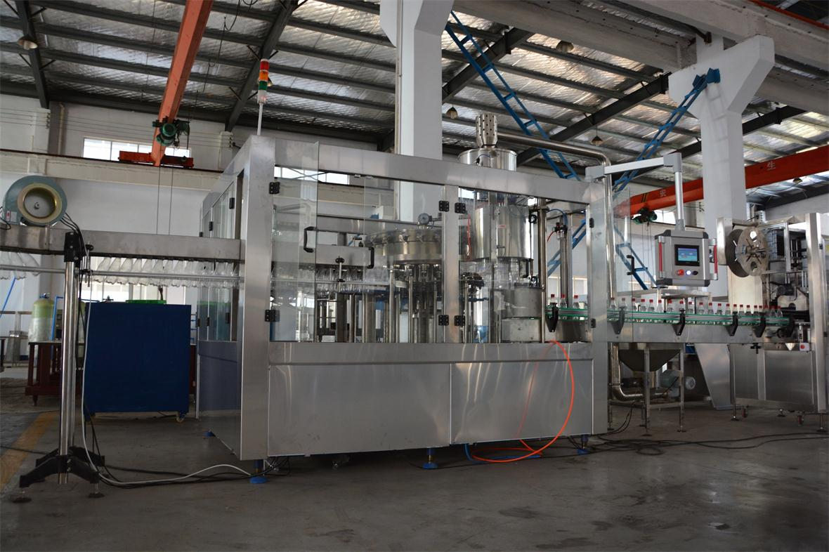 AUTOMATIC CARBONATED SOFT DRINK (CSD) BOTTLING MACHINE