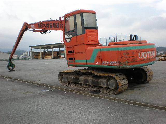 used UOTANI KLG9000 logging machine on HITACHI EX200-3