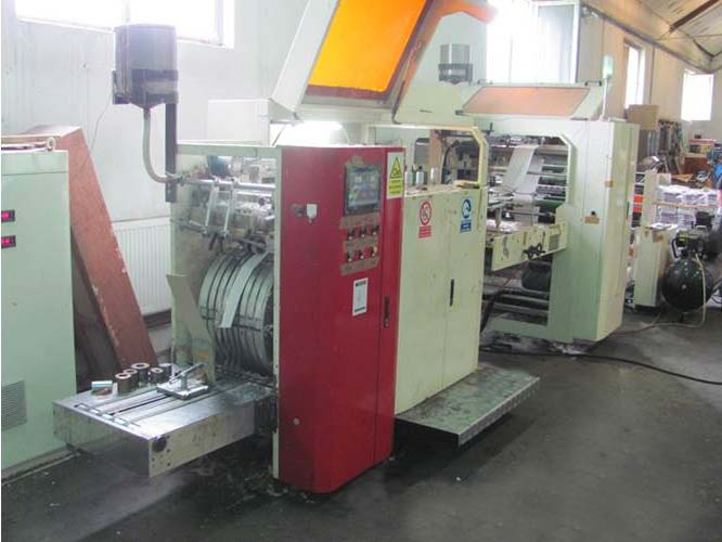 Flat bag making machine with window film application