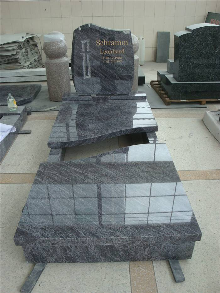 large black headstones with cross