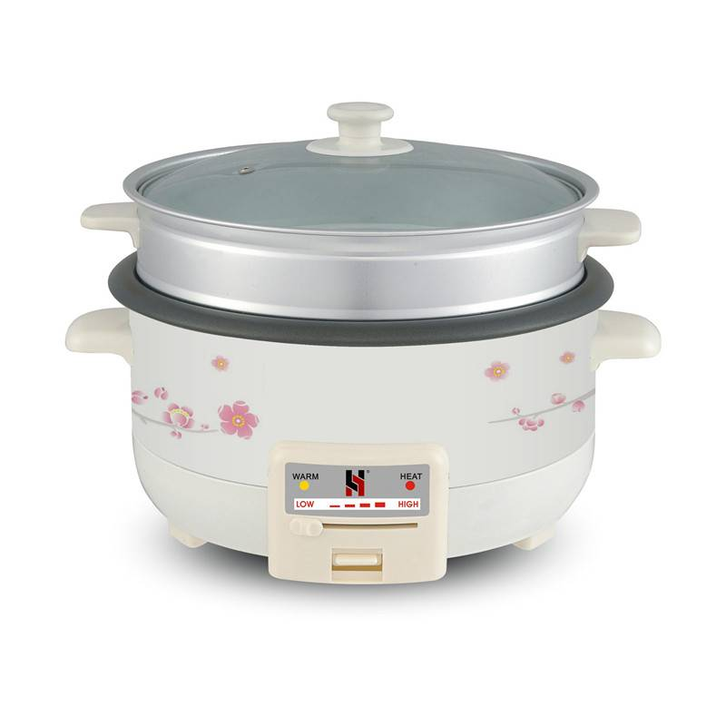 Slow cooker with steamer