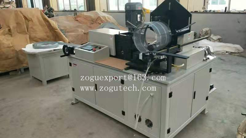 expansion spiral air filter core rolling machine.