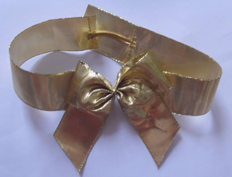 gold flat metallic ribbon butterfly bow with a small metallic elastic.
