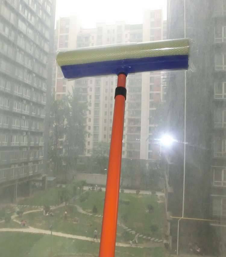 window squeegee on telescopic extension handle pole