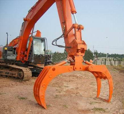 Rotary hydraulic log grapple