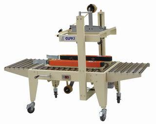Side belts driven carton sealer