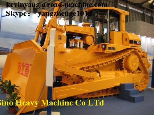 SD8B bulldozer is track-type dozer with elevated sprocket, hydraulic direct drive, semi-rigid suspen