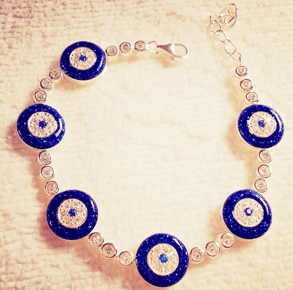 blue shiny evil eye tennis bracelet
