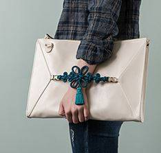 Bag with knot handicraft ornament