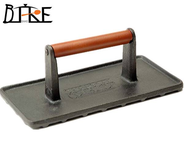 Cast iron grill press with wooden handle