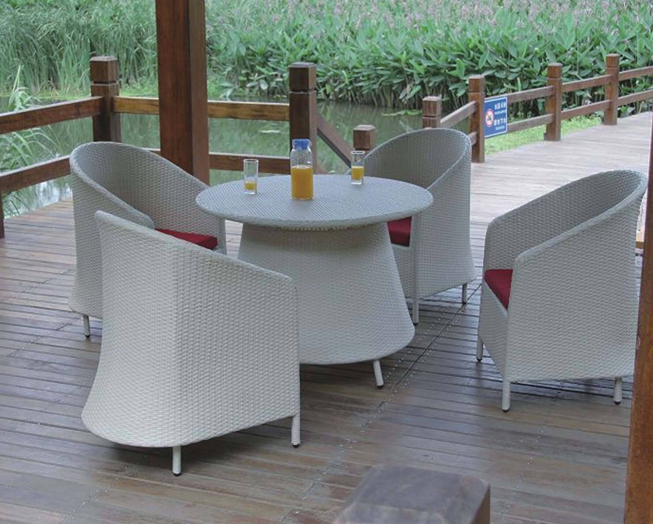 Outdoor dining chair and table, made of rattan woven