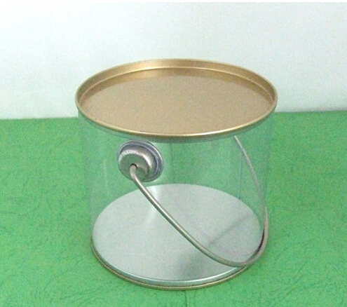 Clear plastic cylinder with tin lid and handle