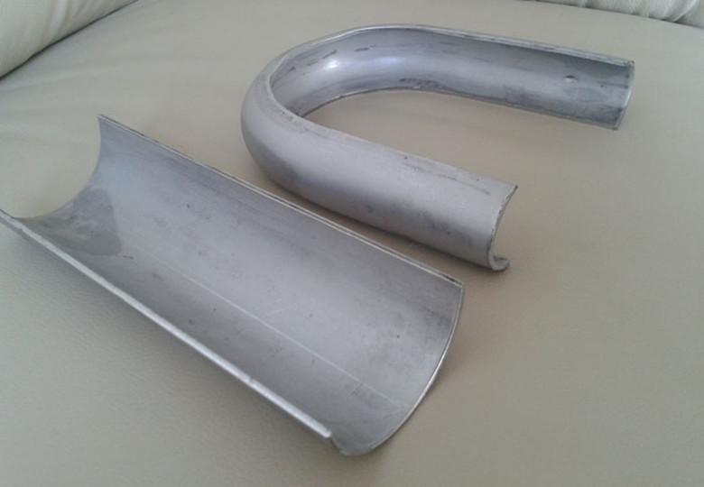 Elbow wear plate for boiler heater
