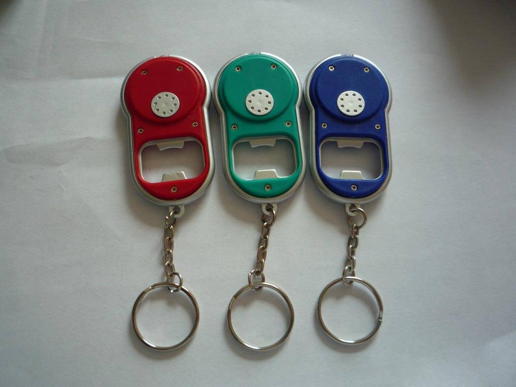 ellipse shape bottle open with LED key chain