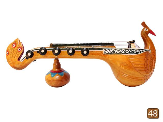 Wooden engraved musical miniatures -Veena adorned with a peacock