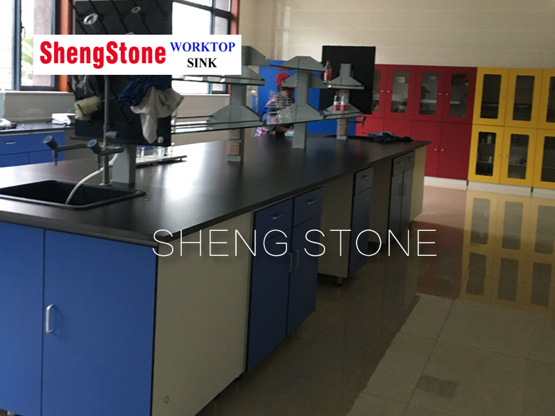 Chemical resistant phenolic resin worktop and corrosion resistant compact cabinet