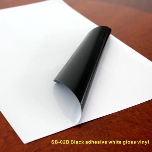 Black adhesive white gloss vinyl