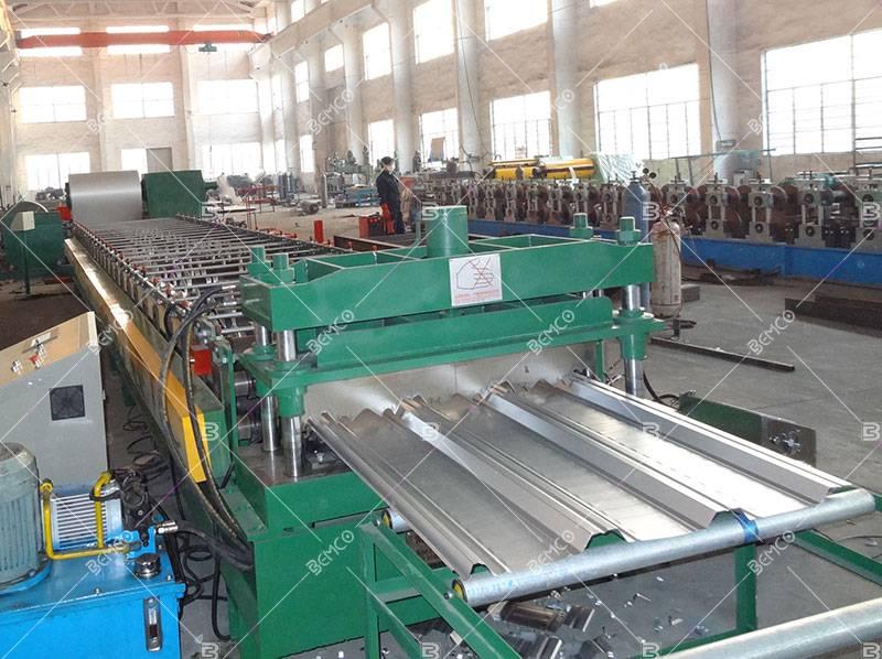 Composite steel floor deck roll forming machine