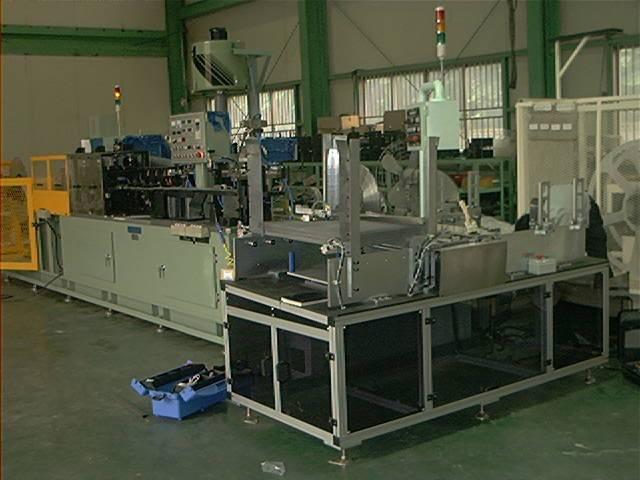 Fin stacking machine