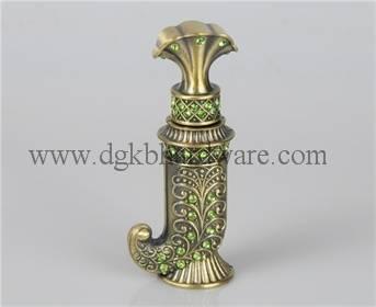 Antique metal perfume bottle