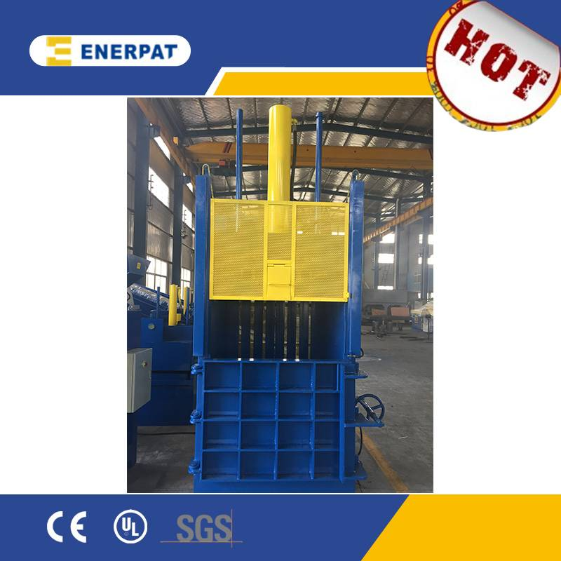Vertical waste carton baler