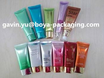 cosmetic packaging tube with metalized top cap flat tube