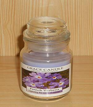 Verbena scented candle in small glass jar