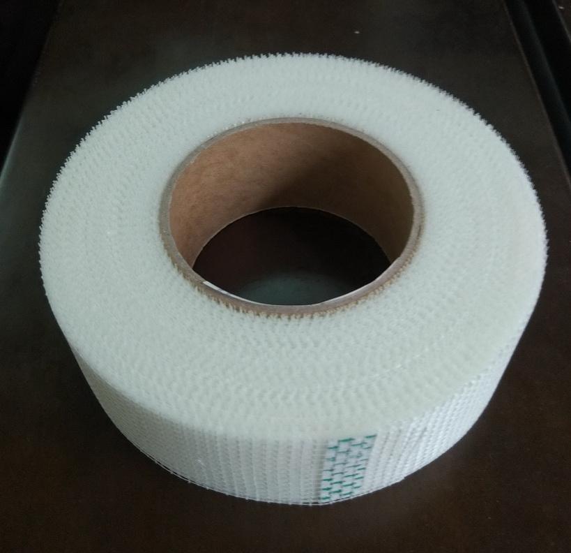 Self adhesive drywall plaster fiberglass tape for joints strengthening