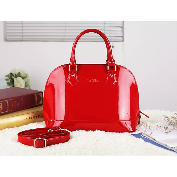 Women's classic artistic laptop bag is made of fine patent leather with sunshine colour