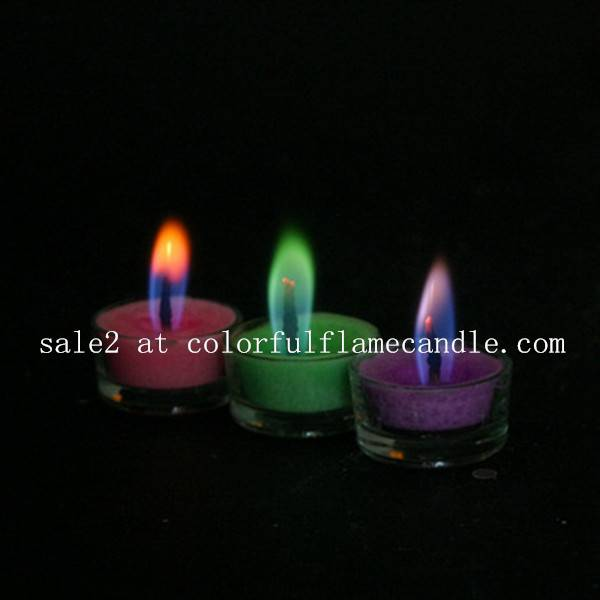 Colored flame candle with glass holder