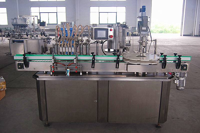 Autoamtic liquid filling and capping machine