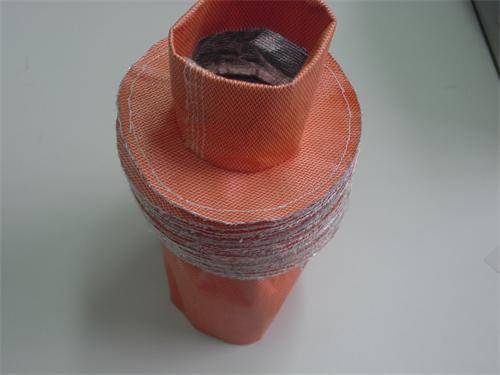 Non metallic fabric compensator