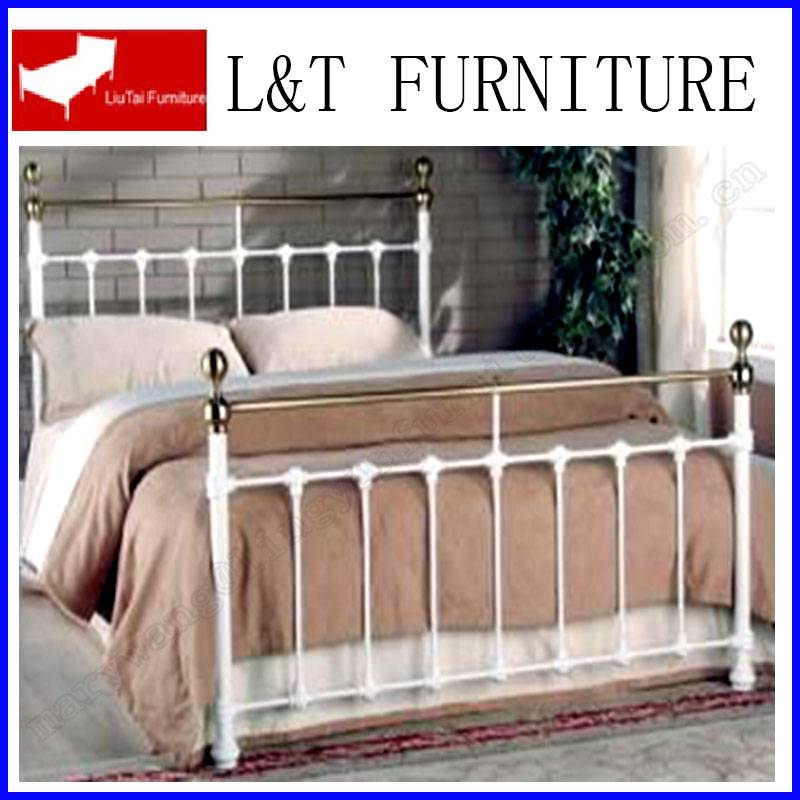 white full size iron bed with golden ball