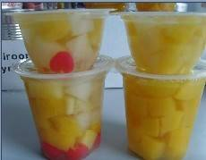 yellow peach dice in plastic cup