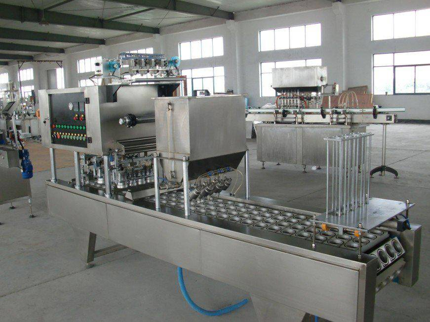 Liquid/sauce/paste cup filling and sealing machine